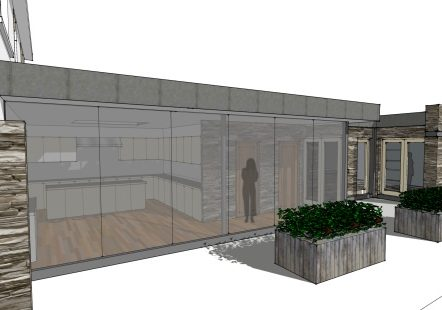 contemporary kitchen behind full height curtain wall glazing to south west elevation open onto external courtyard